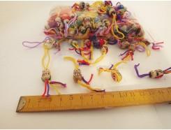 9170001 Gelukspoppetjes klein 1,5 cm. Zakje 144 stuks.