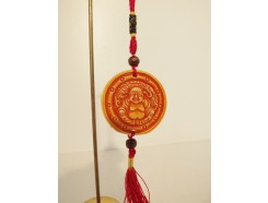 7102038 Hanger oranje amulet met boeddha 4,5 cm. diameter. Per 12 stuks verpakt. € 1,50 per stuk.
