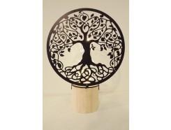 L22196A Led lamp. Zwart metalen Tree of Life (diameter 18 cm.) met buisvormige led lamp op ronde houten basis (diameter 7 cm.). Totale hoogte 24 cm. Op 3 AAA batterijen (niet meegeleverd).